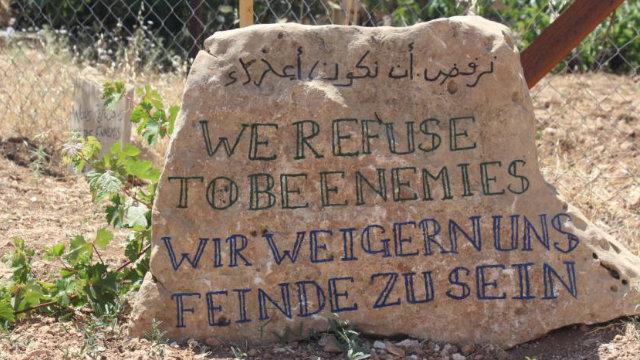 we-refuse-to-be-enemies-stone